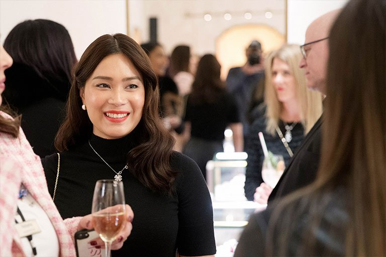 A stylish guest smiling at the Bulgari Chadstone launch