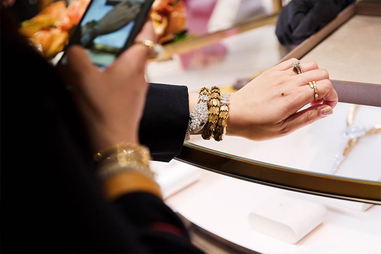 A guest trying on a selection of bracelets and rings at the Bulgari Chadstone launch