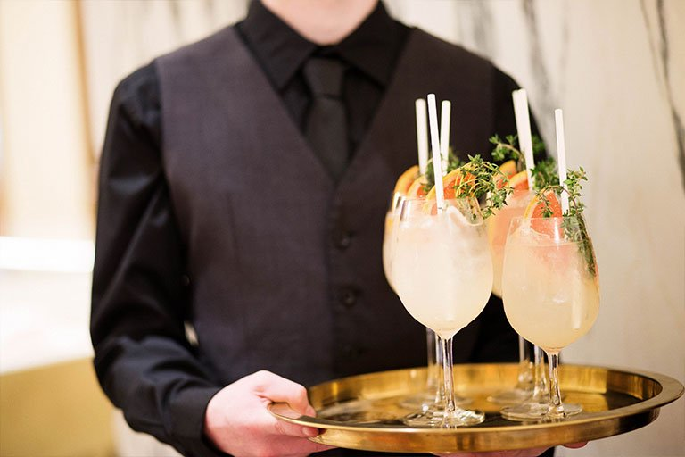 A waiter with a tray of cocktails at the Bulgari Chadstone launch