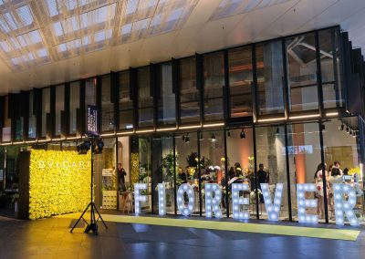 Yellow carpet, light display and flower wall at the Bulgari Fiorever Launch