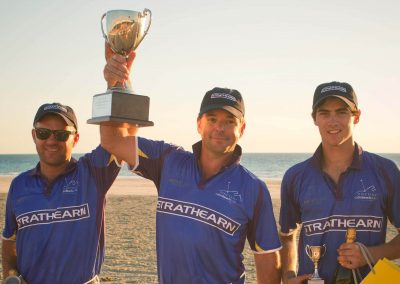 Players holding cup Cable Beach Broome Polo Tournament
