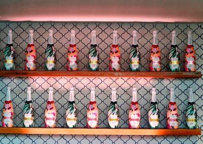 bottles displayed on shelf Chandon x Seafolly PR launch event