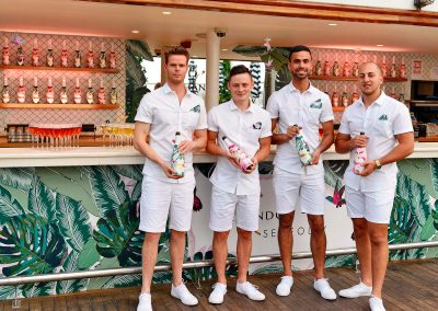 4 male bartenders holding bottle Chandon x Seafolly PR launch event
