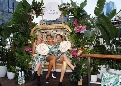 3 female models sitting rotan lounge Chandon x Seafolly PR launch event
