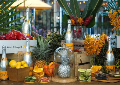 Champagne bottles display with fruit Clicquot Beach House