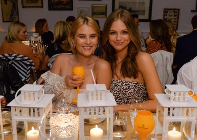 2 models at table Clicquot Beach House