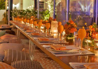 Dining table set orange theme colour Clicquot Beach House
