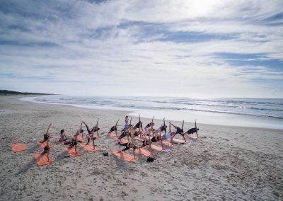 Group yoga at beach Clicquot Beach House