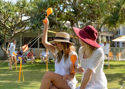 2 female models holding goblets Clicquot Beach House