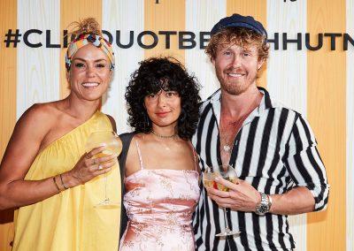 Guests smiling posing Clicquot Beach Hut at Bondi Beach event