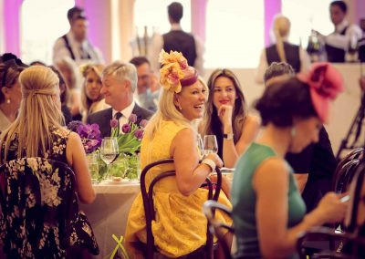 Guests at table talking laughing Crown Resorts Sydney Ladies Luncheon