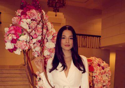 Model holding flower arrangement Crown Resorts Sydney Ladies Luncheon