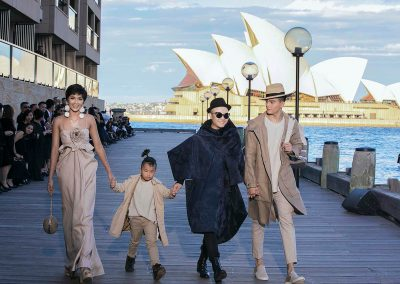 H'Hen Nie and Le Xuan Tien (far right) took to the catwalk with designer Do Manh Cuong and his young son