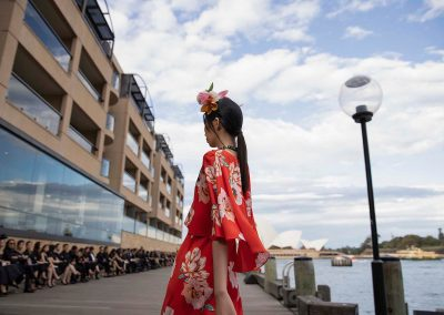 Model in red floral dress at Do Manh Cuong Back to Nature Fashion Parade
