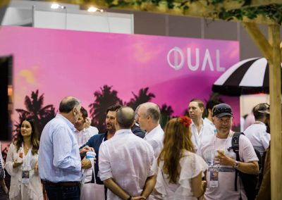 Guests talking Dual Australia Exhibition Stand - Miami Poolside