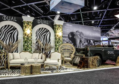 Display vintage car lounge chairs sitting area Dual Australia Exhibition Stand Safari Glam
