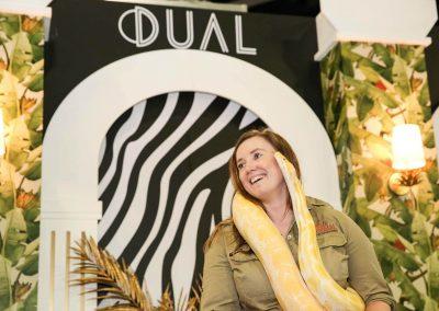 Entertainer holding snake Dual Australia Exhibition Stand Safari Glam
