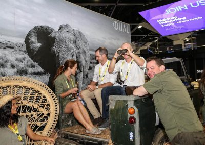 Guests sitting in vintage car Dual Australia Exhibition Stand Safari Glam