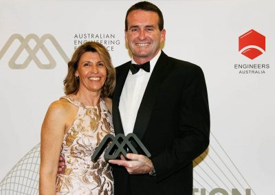 Female and male holding award Engineering Excellence Awards Roadshow
