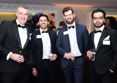 Men smiling holding drink Engineering Excellence Awards Roadshow