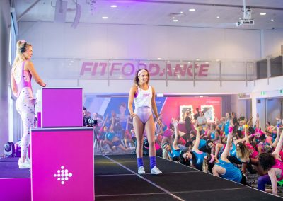 Trainer Brittney Coutts leading a Fibit inspired warm up and cool down