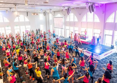 An aerobics class for 150 attendees at the Free Your Fit FitBit event