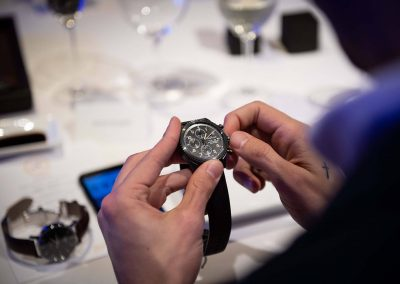 Close up of hands holding watch at Gregory Jewellers & Breitling VIP client dinner