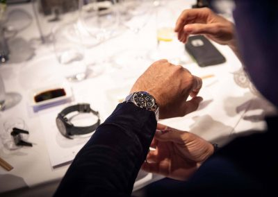 Close up guest's arm at Gregory Jewellers & Breitling VIP client dinner