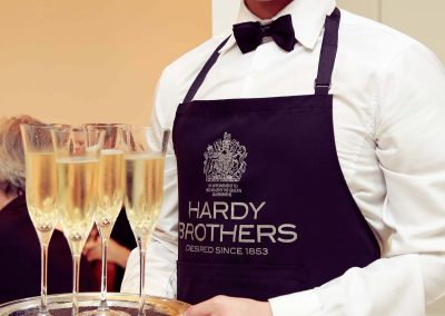 Waiter holding tray drinks Hardy Brothers 160th Anniversary Celebration Dinner
