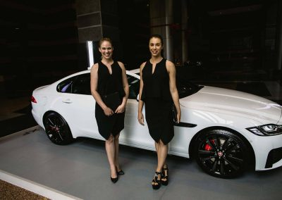 2 models next to car Jaguar XF Australian Launch