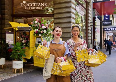 LOccitance staff with gift bags at Store Opening
