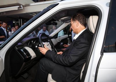 Man sitting in car Land Rover All-New Discovery Launch