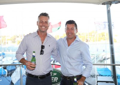2 men smiling holding beers Land Rover All-New Discovery Launch event