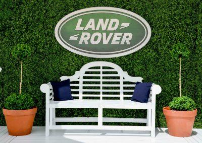 Land Rover logo green wall wooden bench Land Rover Polo Club for Polo in the City English Polo Garden