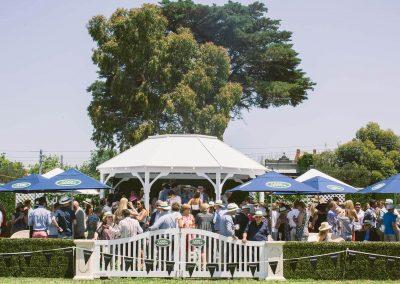 Guests talkiing outside Land Rover Polo Club for Polo in the City English Polo Garden