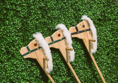 3 wooden horses props green wall Land Rover Polo Club for Polo in the City English Polo Garden