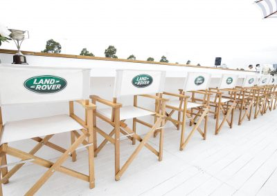 Group of chairs lined up Land Rover Polo Club for Polo in the City Hamptons Polo Club
