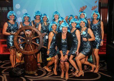 Guests fancy dress posing Mirvac Christmas Party Ahoy Sailor Nautical