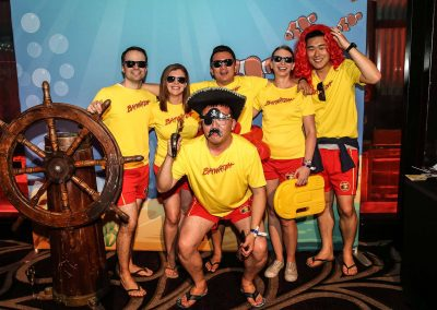 Guests baywatch outfits posing Mirvac Christmas Party Ahoy Sailor Nautical
