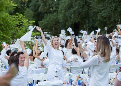 Guests cheering Moet Dinner en Blanc National Sponsorship Activation