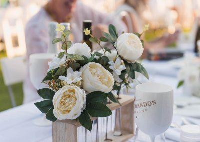 Close up flowers and goblet Moet Dinner en Blanc National Sponsorship Activation