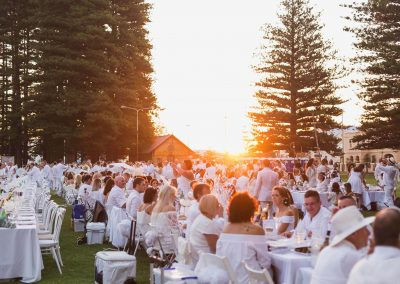 Guests sitting at tables outdoors Moet Dinner en Blanc National Sponsorship Activation