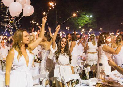 Guests celebrating Moet Dinner en Blanc National Sponsorship Activation