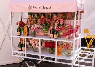 Display cart with champagne and flowers