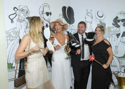 Guests laughing posing Moet Spring Champion Stakes Day VIP Corporate Hospitality Lounge