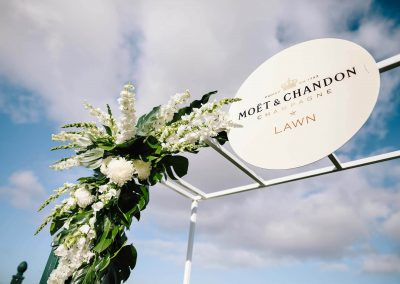 Floral display and metal sign Floral display wooden horses Moet et Chandon Lawn at Melbourne Racing Club