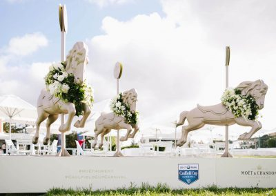 Floral display wooden horses Moet et Chandon Lawn at Melbourne Racing Club