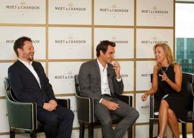 Guests talking to Roger Moet et Chandon Tribute to Roger Federer event
