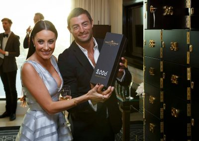 NRL player holding champagne box Moet et Chandon Tribute to Roger Federer event