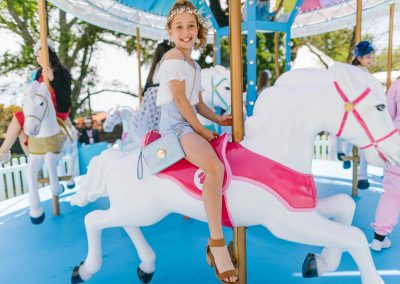 Young girl riding the Network 10 Carousel